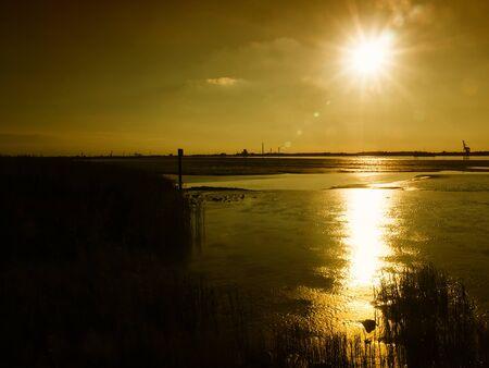 Mudflats in the estuary of Weser river near Nordenham at sunset