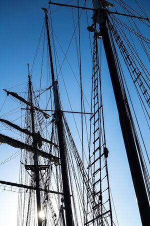 Silhouettes of the masts and rigging of a sailing ship Standard-Bild
