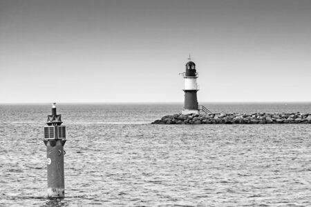 Lighthouse of the eastern pier at Rostock Warnemuende in monochrome