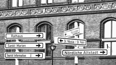 Signs to the points of interest of city Rostock, Germany, monochrome Standard-Bild