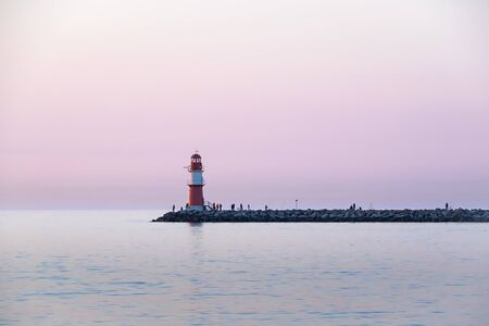Lighthouse of the western pier at Rostock Warnemuende at twilight