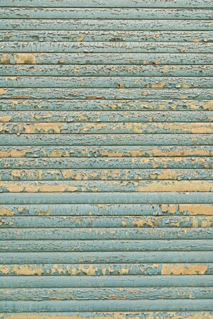 Shutter with blue paint flaking off to use as background