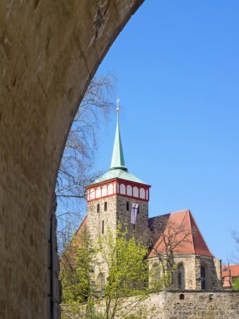 Old town of city Bautzen with church of St. Michael, Saxony, Germany, seen through a bridge arch