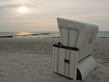 Beach of the Baltic sea at twilight with beach chair, Ahrenshoop, Mecklenburg-Western Pomerania