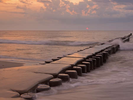 Groyne in the Baltic Sea near to Ahrenshoop, Mecklenburg-Western Pomerania, at sunset