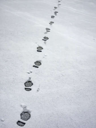 Footprints of man in the snow Standard-Bild