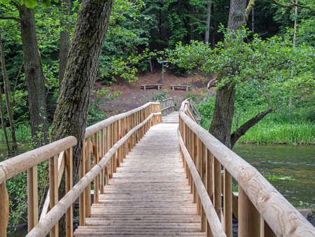 Landscape in Mecklenburg-Western Pomerania with wooden bridge over river Warnow in a forest, Germany