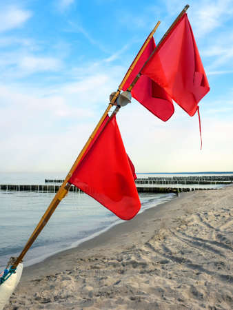 Details of a fishing boat: buoys with red flags at the beach of Ahrenshoop