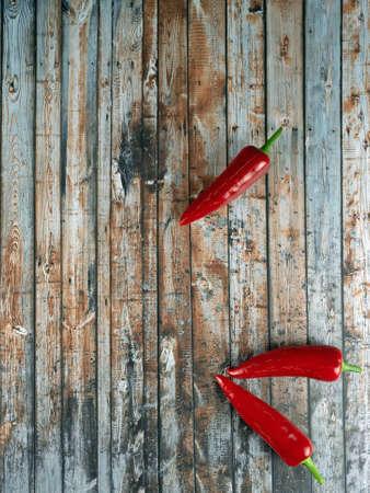 Design of dark wood background with chili peppers Standard-Bild