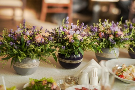 floral decoration: Floral arrangements from lavender and herbs. Wedding party decoration.