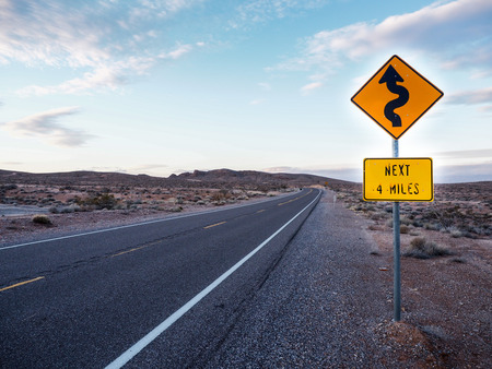 curved ahead road sign