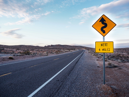 warning curved ahead sign along highway in Page, Arizona