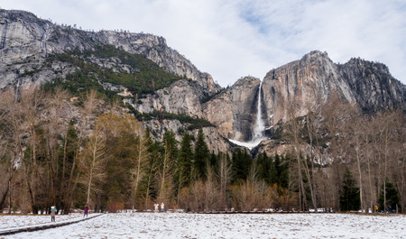 attraction point view for tourist, view of white walkway and waterfall covered by snow in Yosemite National Park in winter