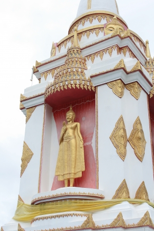 buddah: the golden buddah standing on stupa