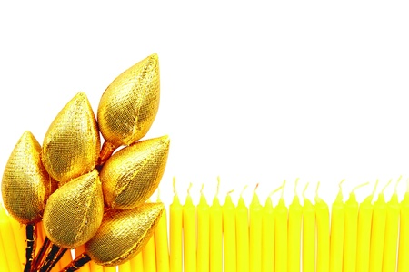 candle wax and golden lotus flower photo