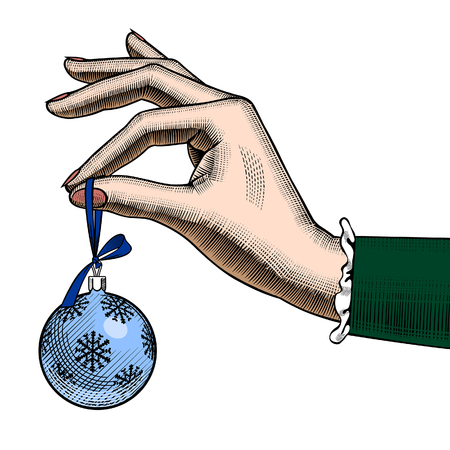 Hand of woman holding a Christmas tree ball. Vintage color stylized drawing. Vector Illustration