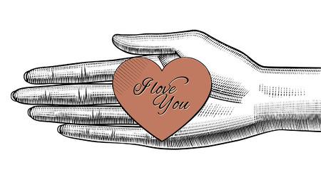 Main de femme tenant sur la paume un coeur en papier rouge avec le lettrage Je t'aime. Conception de carte de voeux de style rétro pour la Saint-Valentin. Dessin stylisé de gravure vintage. Illustration vectorielle