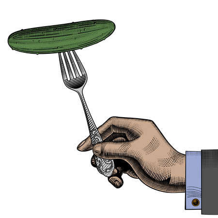Hand holding a fork with a cucumber.
