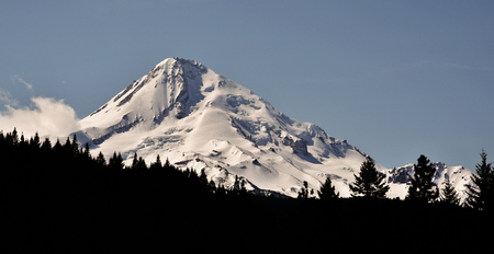 mount hood: Mount Hood, Oregon. Oregons highest mountain at appx 11,232 ft. Covered in snow and viewed from the northeast. In this shot the foreground is darkened to draw attention to the mountain.