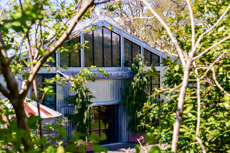 steel sheet: An interesting building made of corrugated tin and glass.