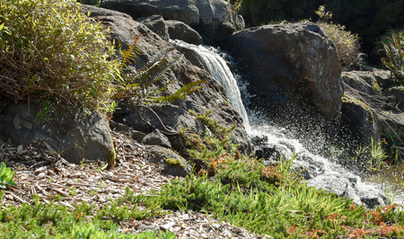 delivers: A small water fall delivers clean water to a pond.