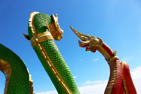 Green and Red colors of Two Molding of Praya Nark showing in Thai Temple Praya Nark or Naga is fabulous serpent or serpent dragon the big snake in Thai story from Thailand