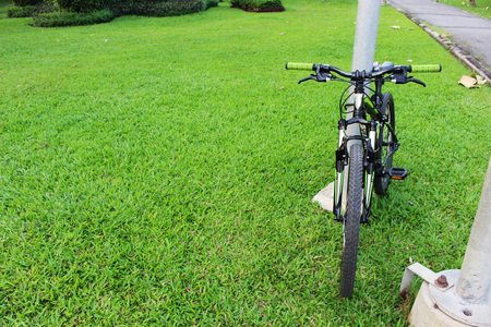 A bicycle in Green natural gaden also called a cycle or bike is a human powered pedal driven single-track vehicle from Thailand Stock Photo