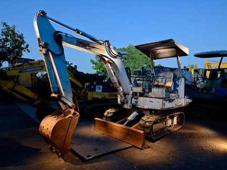 junkyard: Old rusty excavator in junkyard Stock Photo