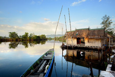 boat house: Thailand Landscape : Local tourism boat house on a river in Songkhla in beautiful morning Stock Photo