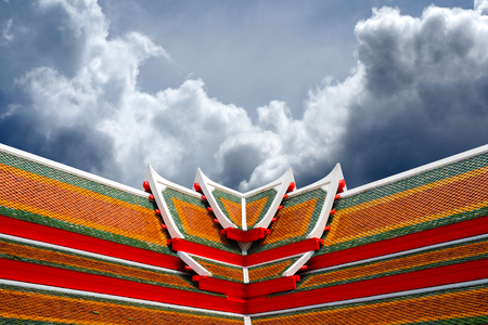 Colorful Thai temple roof with big cloud formation