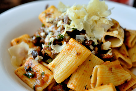Rigatoni pasta in black olive and sundried tomato sauce