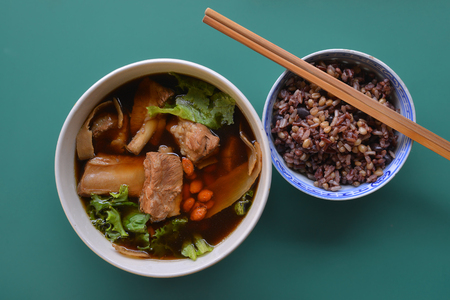 Bowl of Bak Kut Teh with brown rice from top view Stock Photo