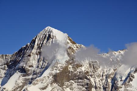 monch: Switzerland Snow Capped Mountains of Interlaken Stock Photo