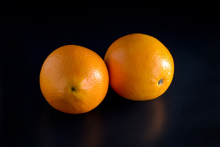 Oranges on black background