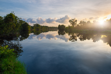 Sunrise over a lake in Songkhla wetland