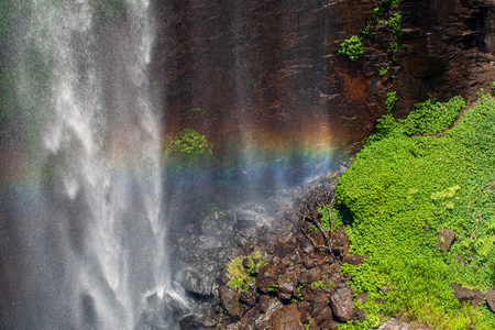 Rainbow on spray from waterfall