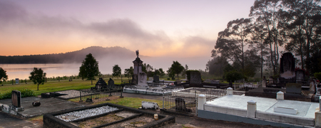 Sunrise at cemetery in North Pine Dam Stock Photo