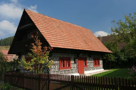 traditionary: Old folkish cottage with painted walls from the Slovakia Stock Photo
