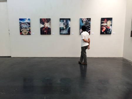 man: Man look at pictures in museum
