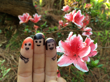 giggling: three smiling fingers on spring time Stock Photo