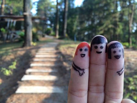 smileys: finger friend smileys with travel symbol Stock Photo