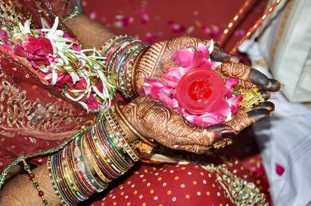 Indian wedding rituals with flower on hands, Indian marriage traditions
