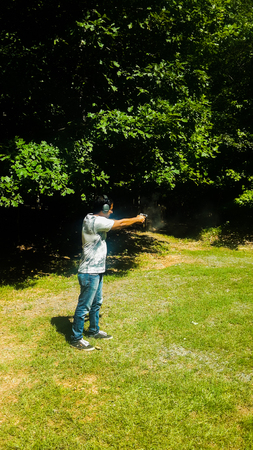 man practicing and aiming shot to target