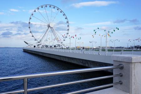 caspian: Big Ferris wheel near the Caspian sea Editorial