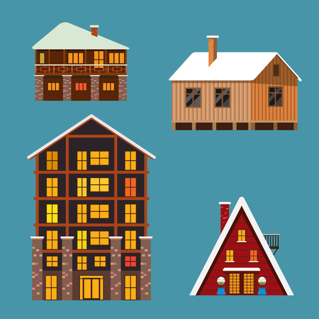 Set of different winter wodden und brick houses and hotels. Isolated on blue background