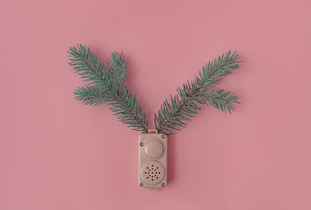 spruce branches in in toy dynamics on a pink background. New Years concept
