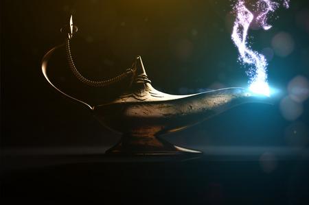 lampara magica: Ancient magic lamp in dark place Foto de archivo