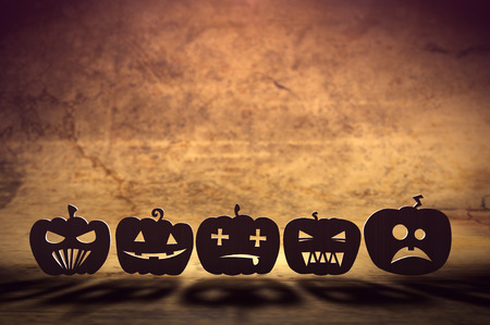 3D illustration of flat pumpkins with various emotions