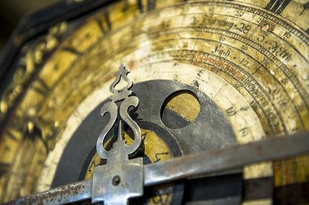 Clock with figured arrow