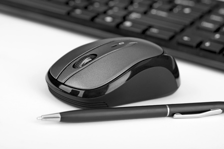 A computers keyboard an a mouse with white background